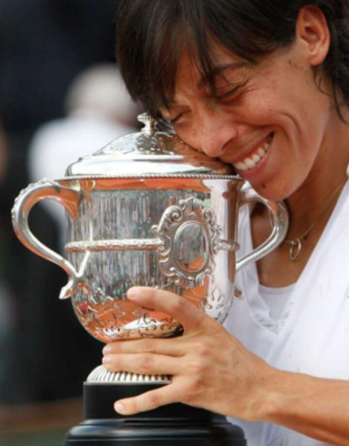 Italy's Francesca Schiavone celebrates her French Open championship after defeating Australia's Samantha Stosur. She won a year after losing in the first round at Roland Garros.