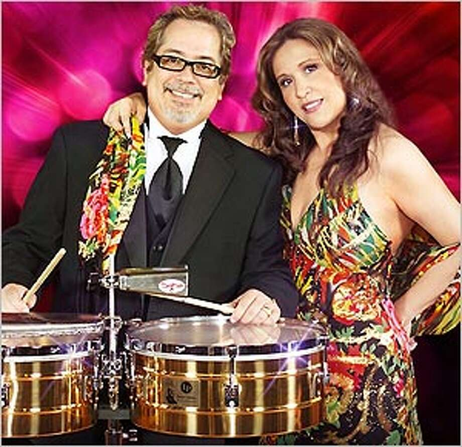 Percussionist Henry Brun poses with his wife, ringer Judi DeLeon.