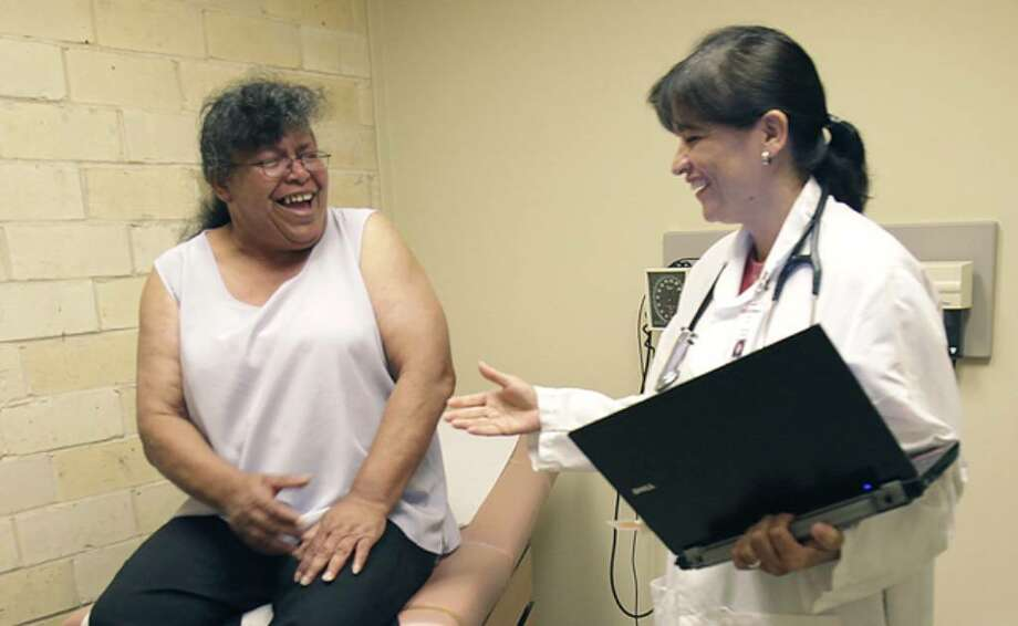 Elizabeth Ealim, left, is greeted by Maria Silva, MPAS, at Centro Med, during her physical exam before going into Haven for Hope.