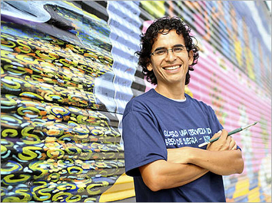 Claudio Aguillon was commissioned by La Gloria's Johnny Hernandez to paint a mural on the restaurant's exterior wall.