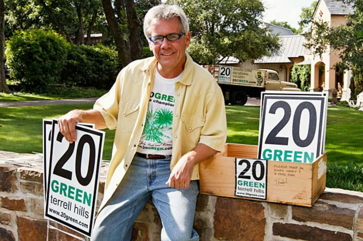 Whit Snell with some 20Green signs outside his home on Geneseo Road in Terrell Hills. The beginnings of this community project can be traced to the efforts of Snell and neighbor Randall Mays, who approached the city of Terrell Hills with ideas on how to make the city safer for a growing number of residents who wished to use the streets for walking, running, and cycling.