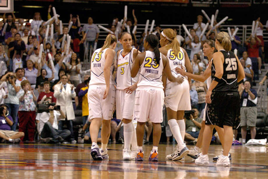 2007: Becky Hammon watches helplessly as the Phoenix fans rise in tribute to the Mercury, led by Diana Taurasi (3), with seconds left in Phoenix's 98-92 series-clinching victory. Hammon and Taurasi face off again starting Thursday.