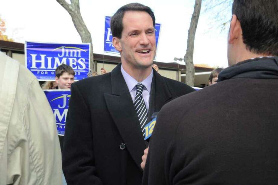 U.S. Rep. Jim Himes D-Conn., speaks with a reporter at Central Middle School after he and his wife Mary had voted on Tuesday, Nov. 2, 2010. Photo: Helen Neafsey / Greenwich Time
