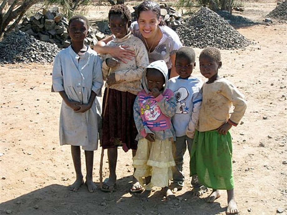Roslyn Nahanson, Five Loaves for Africa director, poses with children on a recent trip to Zambia.