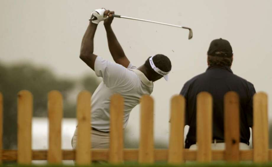 Vijay Singh practices for the Texas Open. Singh, a three-time major winner, is making his first appearance in San Antonio.