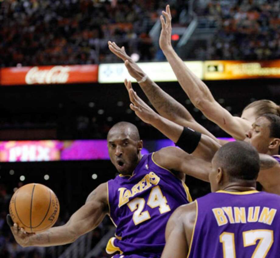 Kobe Bryant passes the ball to Andrew Bynum. Bryant had 38 points, 10 rebounds and seven assists in a losing effort.