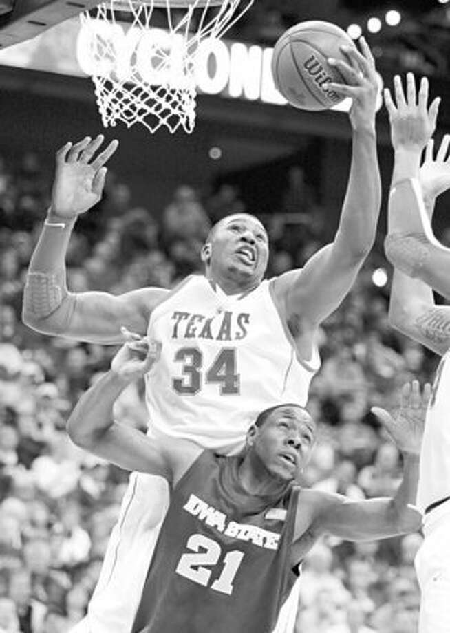 Texas' Dexter Pittman, grabbing a rebound over Iowa State's Craig Brackins, should feel comfortable in New Orleans.