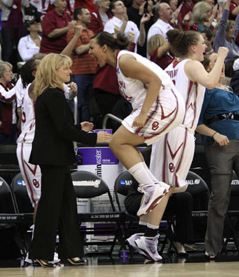 Oklahoma forward Lyndsey Cloman, a freshman from Taft, jumps in front of coach Sherri Coale in the Sooners' Kansas City Regional final win over Kentucky on March 30. Cloman scored two points, had a rebound and an assist in the 88-68 win that sends OU to the Alamodome for the Final Four on Sunday.