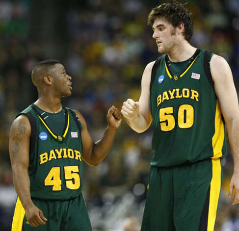 Baylor guard Tweety Carter (left) and center Josh Lomers, a senior from Boerne, share a moment in their regional final loss to Duke on March 28 in Houston. They leave Baylor No. 1 and 2 in games played for the Bears, Carter at 131 and Lomers at 129. / Houston Chronicle