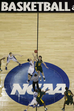 Baylor's Josh Lomers (right), a senior from Boerne, jumps center in his 76th and final collegiate start against Duke's Brian Zoubek in the South Regional final on March 28 in Houston. Lomers leaves Baylor as the school's career leader in field-goal percentage (66.3), first in victories (82 to Tweety Carter's 81), second in games played (129), second in Big 12 wins (28) and seventh in blocks (87). / Houston Chronicle