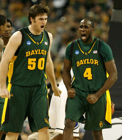 Baylor center Josh Lomers (left), a senior from Boerne, and forward Quincy Acy celebrate a play in the Bears' 78-71 loss to Duke in the South Regional final on March 28. / Houston Chronicle