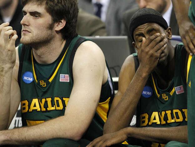 Baylor's Josh Lomers (left), a senior from Boerne, and Anthony Jones watch as the Bears' 28-8 season ends in a 78-71 loss to Duke in a region final on March 28. Lomers leaves Baylor as the school's career leader in field-goal percentage (66.3), first in victories (82 to Tweety Carter's 81), second in games played (129), second in Big 12 wins (28) and seventh in blocks (87).