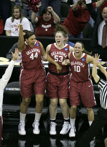 Oklahoma's Lyndsey Cloman (left), a freshman from Taft, Joanna McFarland and Carlee Roethlisberger celebrate the team's 77-72 win over Notre Dame in overtime on March 28. A victory on Tuesday against Kentucky will bring Cloman home for the Final Four at the Alamodome.