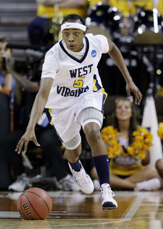 West Virginia's Sarah Miles, a junior point guard from Sam Houston, races upcourt in a second-round loss to San Diego State in the NCAA tournament on March 23. Miles played all 40 minutes and scored 15 points, but she only had two assists, four below her season average.