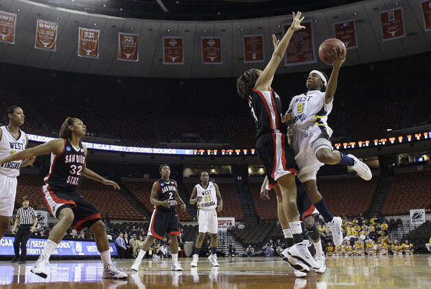 West Virginia's Sarah Miles, a junior from Sam Houston, shoots against San Diego State's Jessika Bradley in the Mountaineers' 64-55 second-round loss on March 23. In her first season as a point guard, Miles had 200 assists, good for fourth on West Virginia's single-season charts and second-best for a junior. She ranks fifth best in school history with 95 steals this season.
