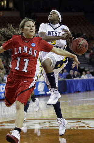 West Virginia's Sarah Miles (right), a junior from Sam Houston, has the ball knocked out of her hands by Lamar's Jenna Plumley in the Mountaineers' 58-43 victory in the first round of the NCAA tournament on March 21.