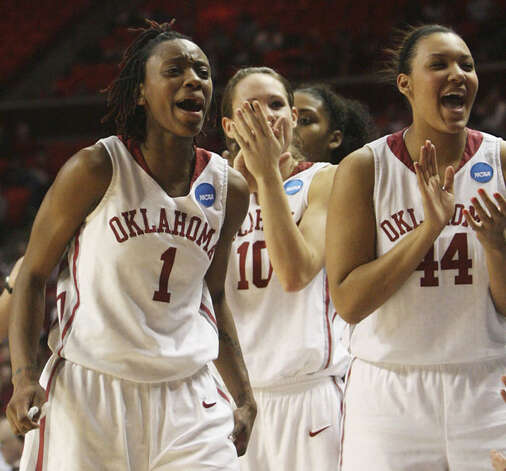 Oklahoma forward Nyeshia Stevenson (left), forward Carlee Roethlisberger (center) and forward Lyndsey Cloman, a freshman from Taft, cheer after a blocked shot in the third-seeded Sooners' win over South Dakota State on March 21 in Norman, Okla. OU faces Arkansas-Little Rock on Tuesday at 8:45 p.m., with the winner advance to the Sweet 16 in the Kansas City Region.