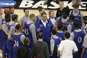 Kansas guard Chase Buford (far left), a junior walk-on from Alamo Heights, and his teammates listen to coach Bill Self (center) before their first-round victory over Lehigh. However, the top-seeded Jayhawks didn't survive Oklahoma City, losing to Northern Iowa in the second round.