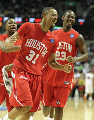Houston's Adam Brown, a junior guard from Churchill, celebrates after hitting a 3-point shot with time expiring in the first half against Maryland in the first round of the NCAA tournament on March 19. Brown's buzzer beater left the Cougars trailing 39-37 at half, but the Terrapins won 89-77. / 2010 Getty Images