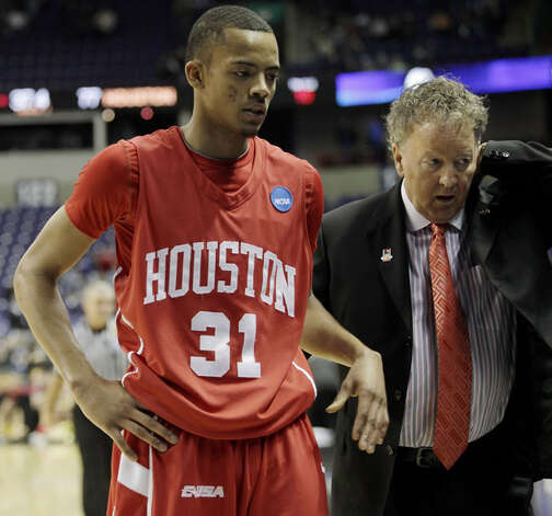 Houston guard Adam Brown, a junior from Churchill, walks off the court with head coach Tom Penters after Houston lost 89-77 to Maryland in an NCAA first-round game in Spokane, Wash., on March 19. Brown had 11 points, finishing the season averaging 7.9 points and 19.8 minutes in his first year with the Cougars (19-16).