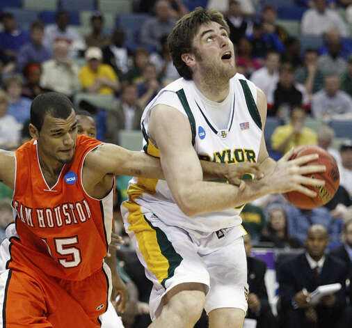 Baylor center Josh Lomers, a Boerne graduate, tries to get to the basket while Sam Houston forward Preston Brown reaches in during the Bears' first-round victory on March 18. Lomers had three points and three rebounds in 14 minutes in the 68-59 victory, the Bears' first NCAA tournament win in 60 years. Baylor plays Old Dominion at 4:45 p.m. on Saturday with a chance to advance to the Sweet 16 at the South Regional in Houston.