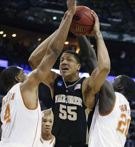 Wake Forest center Tony Woods (center) is defended by Texas guard Gary Jonhson (left) and forward Alexis Wangmene, a sophomore from Central Catholic, in the Longhorns' 81-80 NCAA first-round loss on March 18. Wangmene grabbed one rebound in four minutes of playing time.