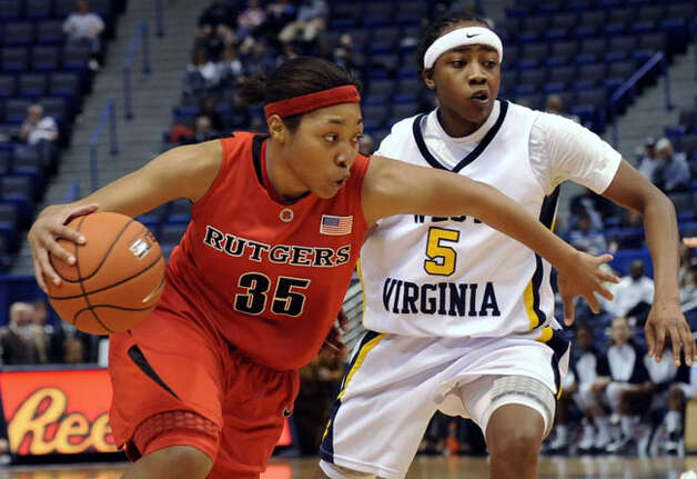 West Virginia point guard Sarah Miles, a junior from Sam Houston, defends Rutgers' Britttany Ray in a Big East tournament game on March 8. Miles and the third-seeded Mountaineers take on Lamar in Austin on Sunday in the first round of the NCAA tournament.