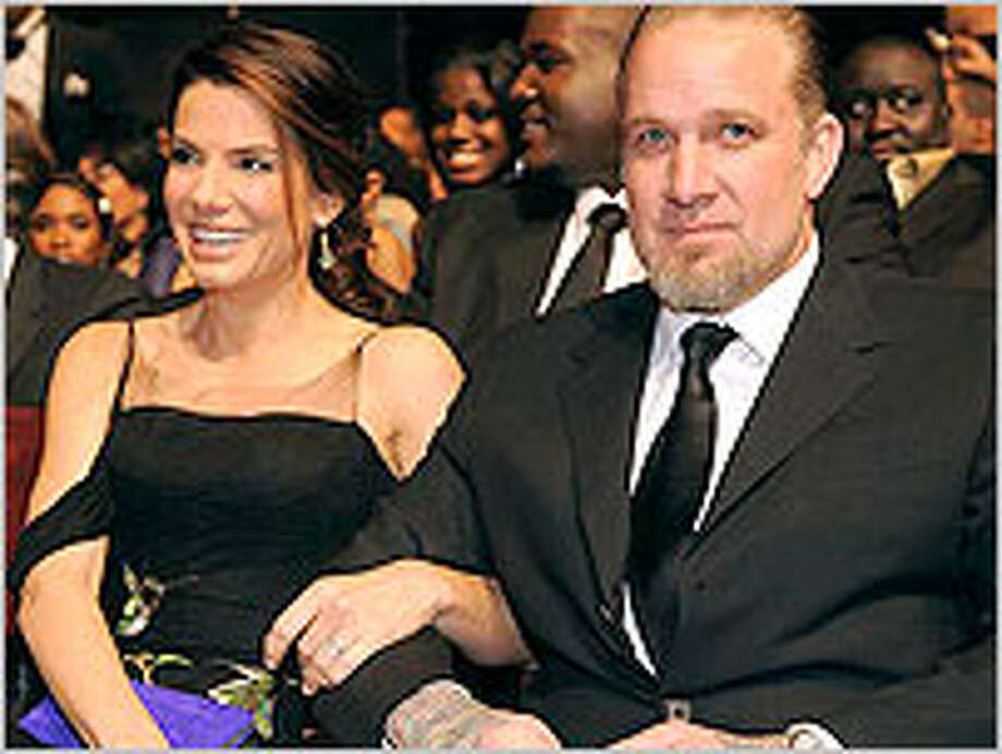 Jesse James (right) admitted to straying from his wife Sandra Bullock.