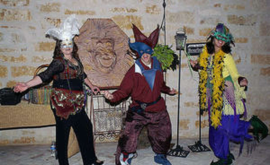 Jesters Jeremy Talamantez and Delaney Mangrum entertain guests.