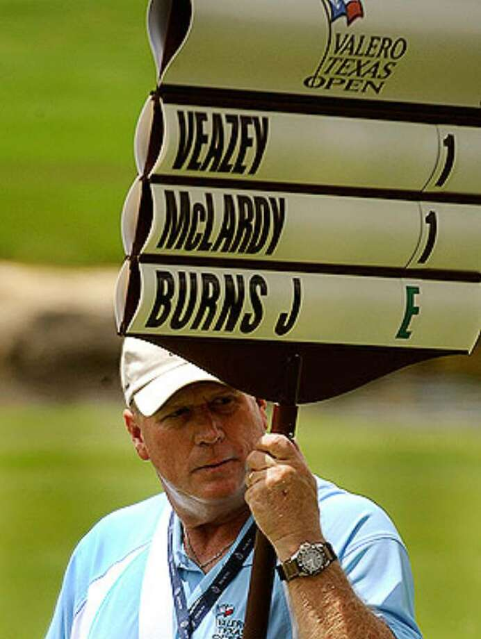 John Simmons volunteers as a standard bearer at the Valero Texas Open, which has more than 1,800 volunteers this year.