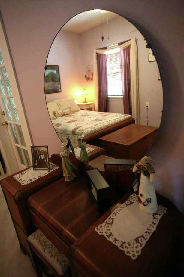 This vanity is just one of the pieces of antique furniture in the lilac guest room.