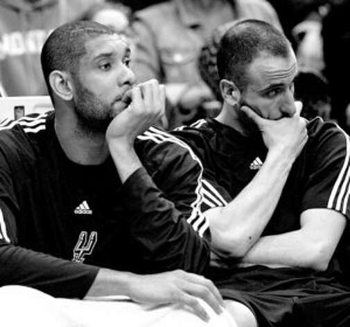 Tim Duncan and Manu Ginobili rest during the fourth quarter Wednesday, but they played significant minutes.