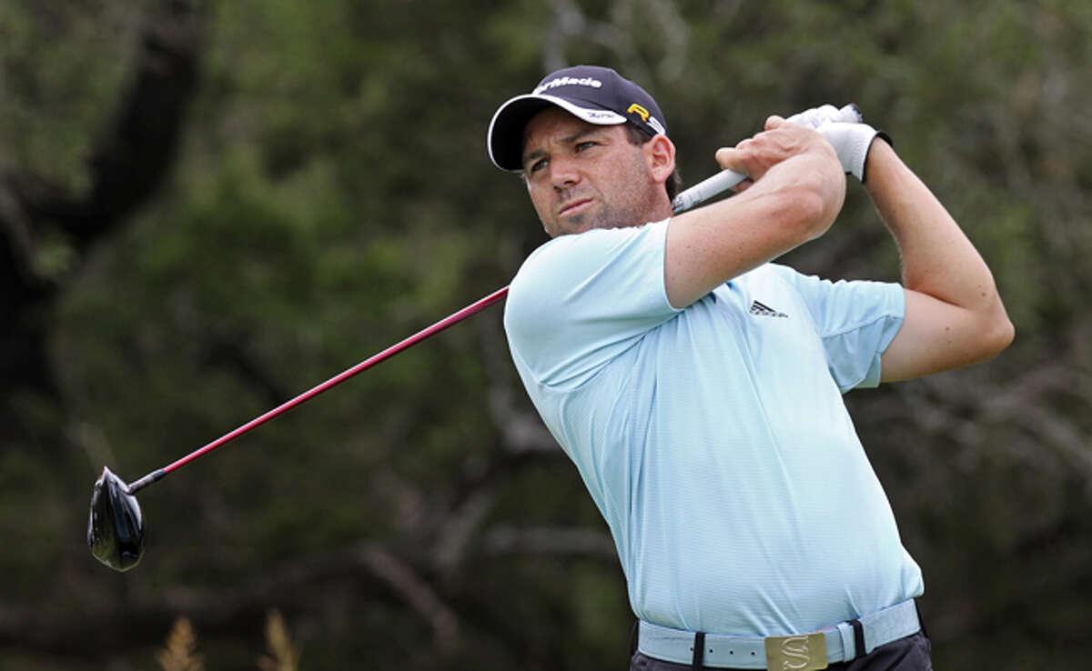 Sergio Garcia, a consultant to course designer Greg Norman, hits off the 12th tee at the AT&T Oaks at TPC San Antonio on Wednesday. The Valero Texas Open moved to far north Bexar County after 15 years on the Resort Course at La Cantera, which routinely produced low scores.