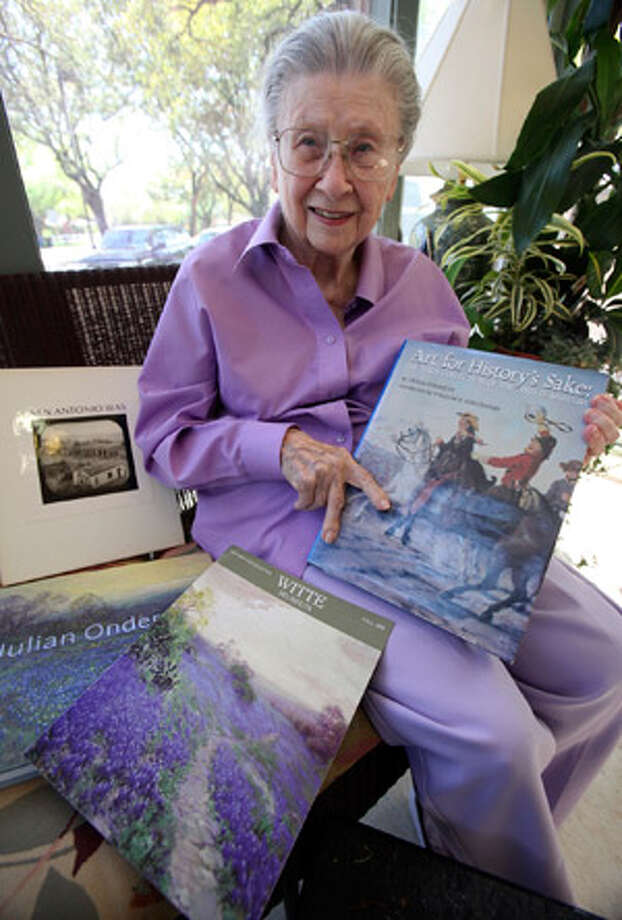 Cecilia Steinfeldt displays some of her Witte-related publications as she sits in a sun room at Morningside Manor.