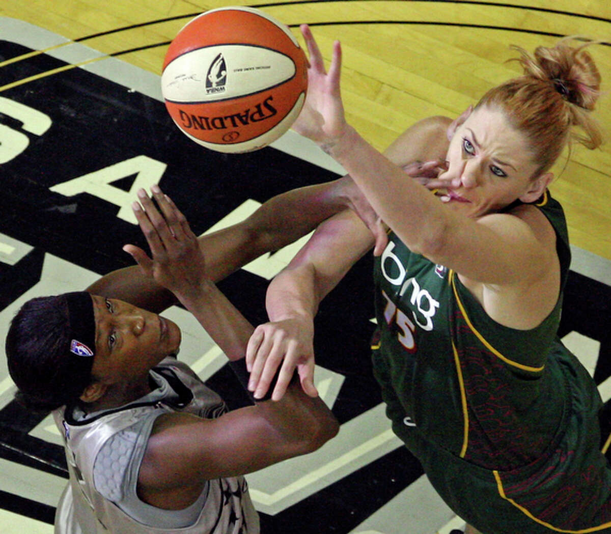 The Silver Stars' Michelle Snow (left) and Storm's Lauren Jackson go up for the ball during the tipoff Sunday.