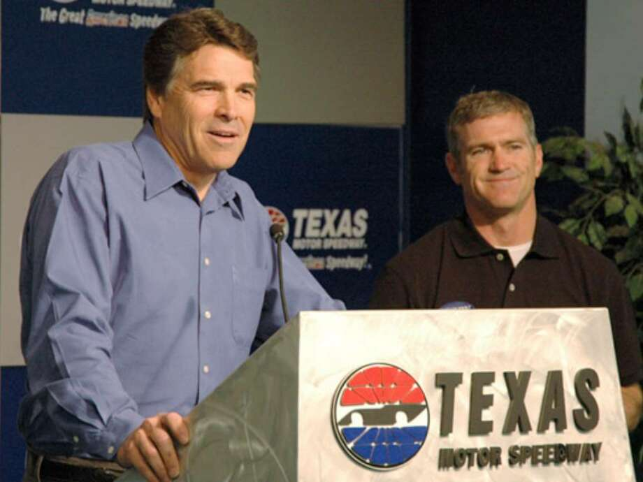 Rick Perry appears with NASCAR driver Bobby Labonte, whose car the governor's re-election campaign is sponsoring in today's race at the Texas Motor Speedway in Fort Worth.