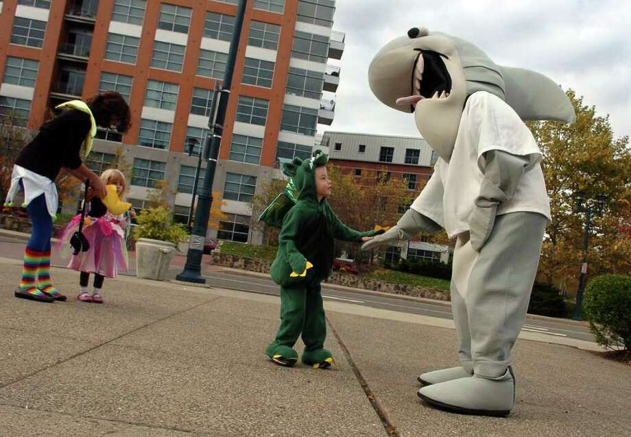 "Zachary Ayers, 4, of Bristol, greets the Maritime Aquarium shark before going inside to attend the aquarium's ""Halloween Hoot"" celebration on Friday October 29, 2010. Anyone who came in a costume was able to get in for free and enjoy trick-or-treating in the aquarium's galleries and take part in a costume contest and parade. Photo: Christian Abraham / Connecticut Post"