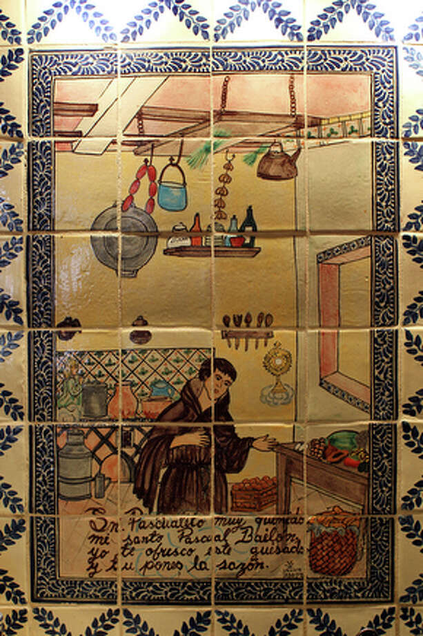 Hand painted tiles she installed herself above the sink in Maxine Oesterling's kitchen. / spoecial to the San Antonio Express-News
