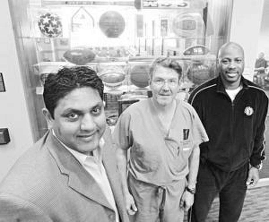 Businessman Tushar Patel (left), Spurs team doctor David Schmidt and Buckner Fanning Christian School athletic director David Jones are working together, using San Antonio as an example of how to promote the growth of sports in Mumbai, India.