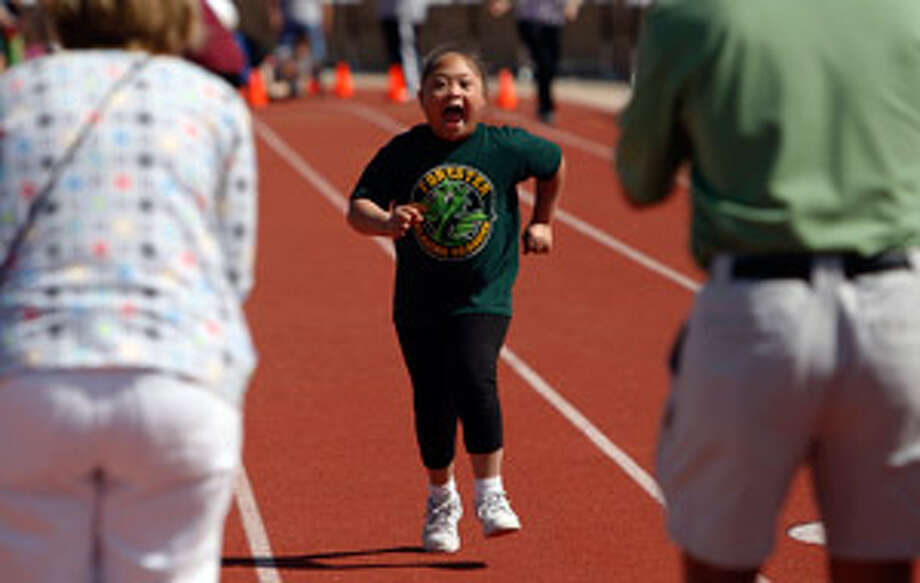 Ayanna Jackson, 8, of Forester Elementary runs toward the finish line at the Special Olympics at Gustafson Stadium on Thursday.