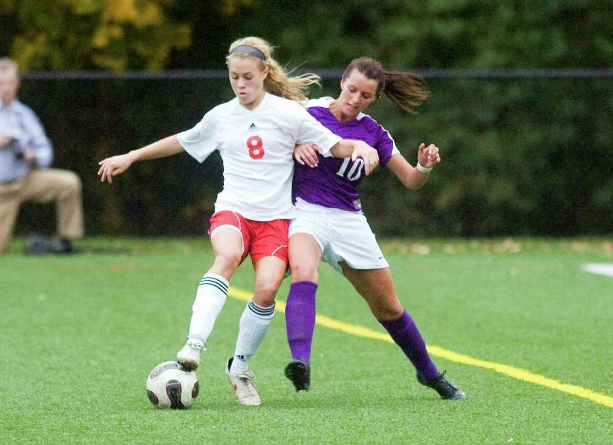 Greenwich's Tori Dunster and Westhill's Aulona Velaj battle for the ball as Greenwich High School hosts Westhill in a girls soccer game Tuesday, October 24, 2010. The game ended with a 1-1 tie.