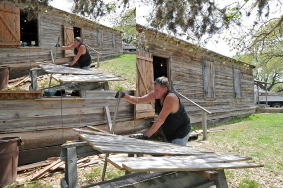 Carpenter Delmis Shields works on preserving the Sisterdale Dance Hall and Community Center.