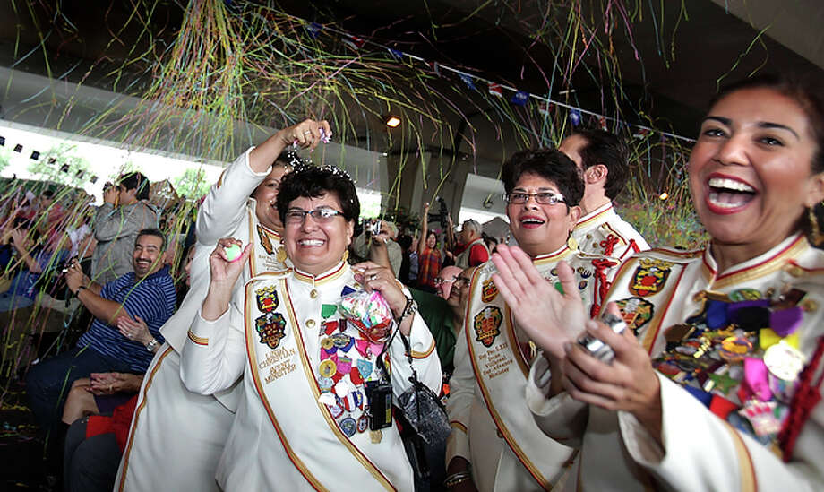 Members of Rey Feo's Court, Linda Christian, center left, gets a cascaron cracked on her head by Debra Guerrero, left, as Irene Villareal, center right, and Eva Esquivel, right, enjoy the official launch of Fiesta 2010 under I-35 at Market Square. / SAN ANTONIO EXPRESS-NEWS