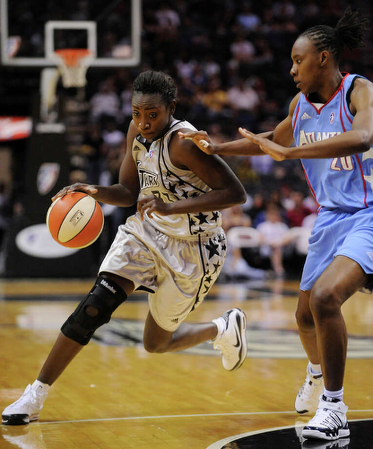Silver Stars' Sophia Young drives around Atlanta Dream's Sancho Lyttle Saturday May 15, 2010 at the AT&T Center. The Dream won 75-70. / © 2010 SAN ANTONIO EXPRESS-NEWS