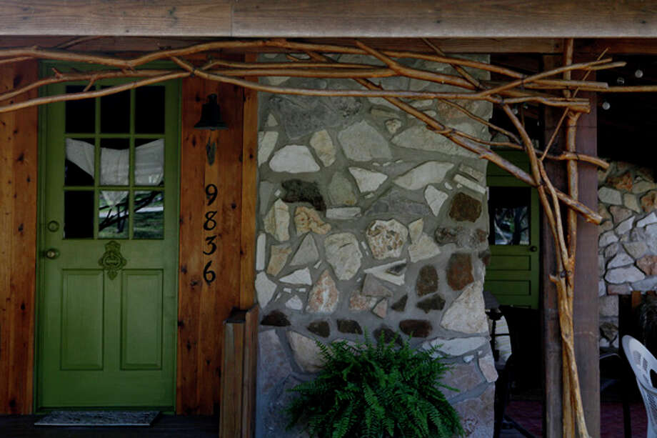 When Christina Nouveau wanted to replace the home's mismatched wooden exterior, she designed and mortared a stone fa?ade. The stones came from the Hill Country, Colorado and New Mexico. / SAN ANTONIO EXPRESS-NEWS