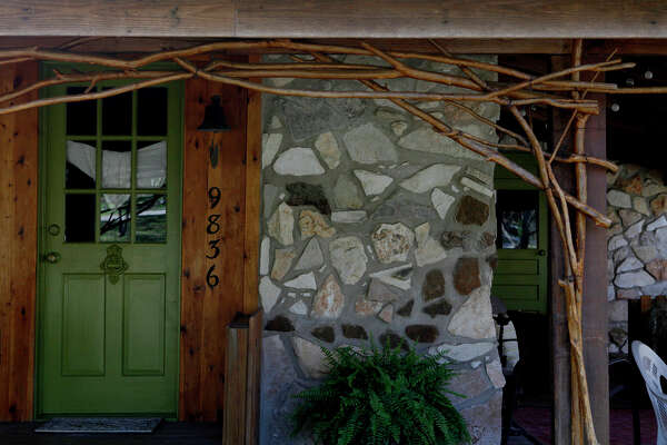 When Christina Nouveau wanted to replace the home's mismatched wooden exterior, she designed and mortared a stone fa?ade. The stones came from the Hill Country, Colorado and New Mexico.