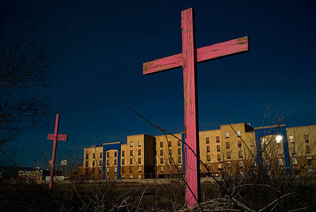 The spot where the bodies of Irma Monreal's daughter, Esmeralda, and seven other teens were found is marked by crosses. / Copyright © 2010 Julian Cardona
