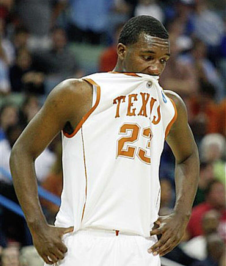 Texas  guard Jordan Hamilton leaves the court after losing in overtime to Wake Forest.