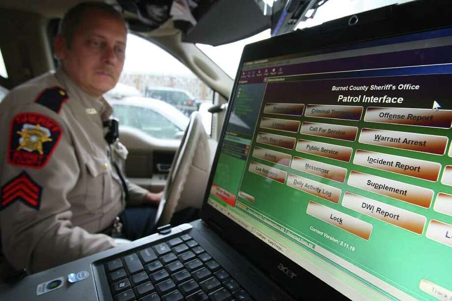 Burnet County Sheriff's Office Patrol Sergeant Gary Ferguson shows the COPsync program on a laptop inside a patrol vehicle in Burnet. / eaornelas@express-news.net