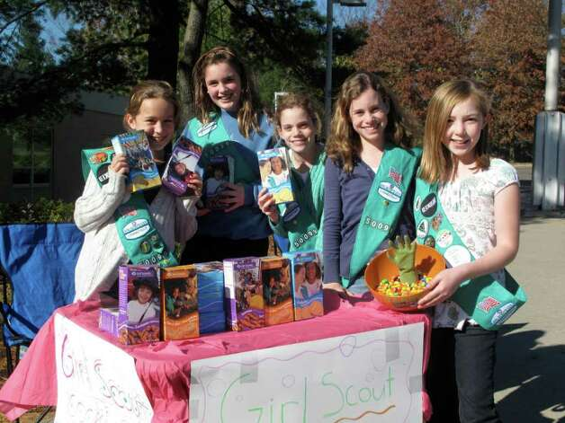 Girl Scout Troop 50099 in Darien sold cookies to voters going into the Ox Ridge School voting site. By 2 p.m. they were almost sold out. From left: Grace Druge, Emily Richards, Lauren Klein, Grace Klein, and Adelade Baxter. Photo: File Photo / Darien News